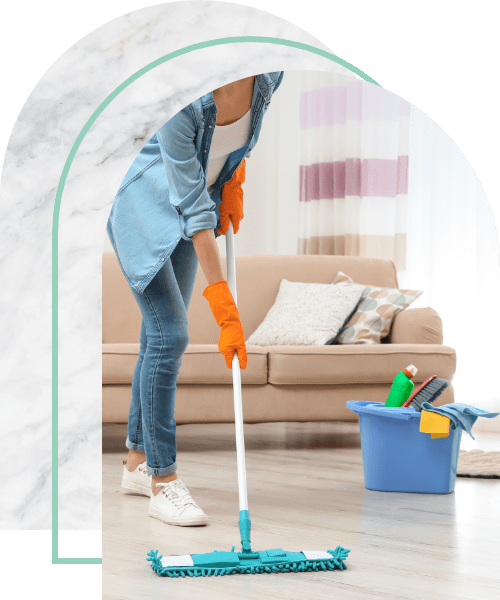 Young woman washing floor with mop in living room
