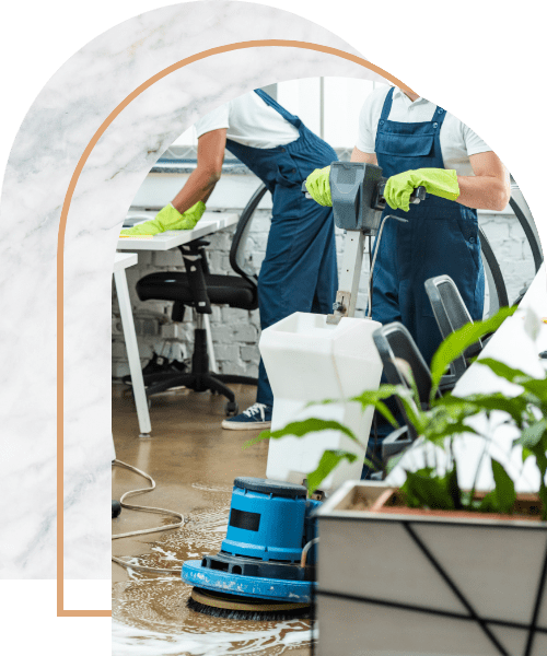 Team of cleaners working in modern open space office