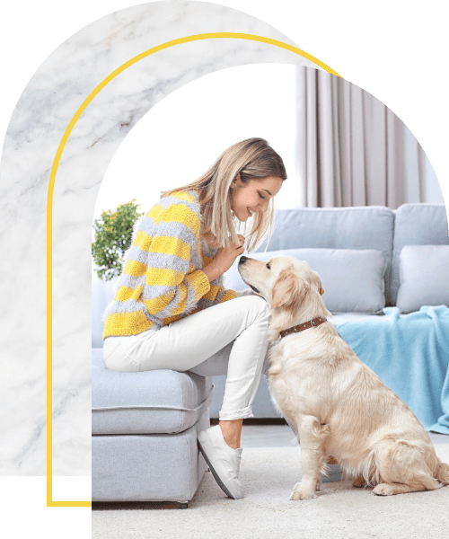 Happy woman with her dog at home