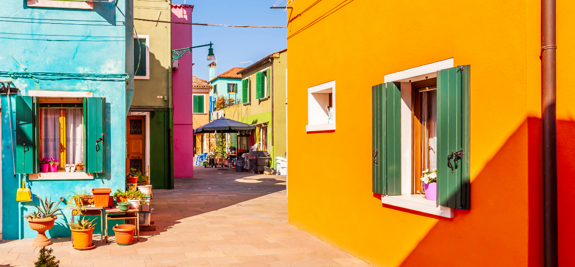 Alleyway with colorful facades on the island of Burano in Venice in Veneto, Italy