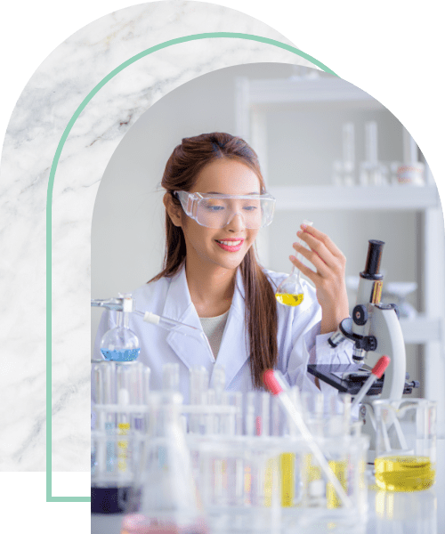 Scientist holding flask with lab glassware