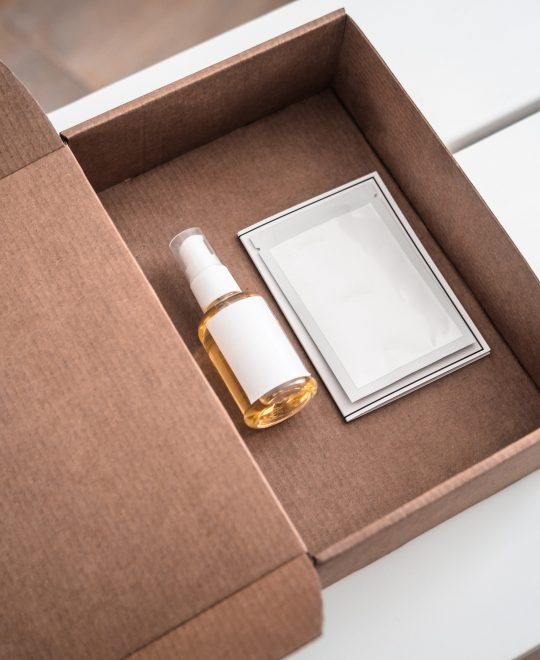 skincare products in craft paper beauty box